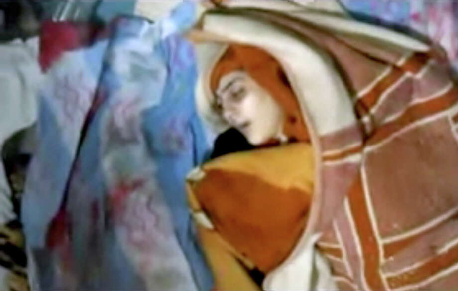 This image made from amateur video released by Shaam News Network and accessed Saturday, June 9, 2012, purports to show a blanket-wrapped body after shelling in Daraa, Syria. Syrian troops shelled the southern city of Daraa early on Saturday, killing more than a dozen people, activists said.(AP Photo/Shaam News Network via AP video)THE ASSOCIATED PRESS CANNOT INDEPENDENTLY VERIFY THE CONTENT, DATE, LOCATION OR AUTHENTICITY OF THIS MATERIAL Photo: Anonymous / Shaam News Network
