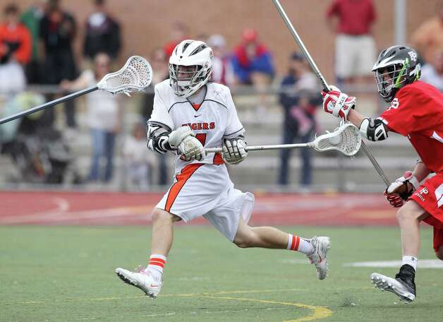 Ridgefield High School attackman Sean Wilkenson fires a shot on goal during second half Class L lacrosse final action at Brien McMahon High School in Norwalk, Conn. on Saturday June 9, 2012. Fairfield Prep upended the Tigers of Ridgefield, 8-6. Photo: J. Gregory Raymond / Connecticut Post Freelance