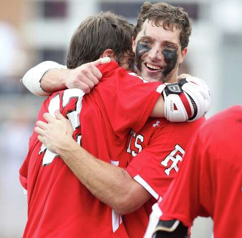 Fairfield Prep players Matt Brophy and Mike Seelye celebrate their 8-6 win  over Ridgefield in the Class L CIAC lacrosse final at Brien McMahon High Schooll in Norwalk, Conn. on Saturday June 9, 2012. Photo: J. Gregory Raymond / Connecticut Post Freelance