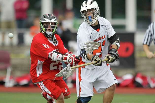 Fairfield Prep player Tim Edmunds and Ridgefield's James Payne eye a loose ball during second half Class L lacrosse final action in Norwalk, Conn. on Saturday June 9, 2012. Fairfield Prep won 8-6. 6/9/12 Photo: J. Gregory Raymond / Connecticut Post Freelance