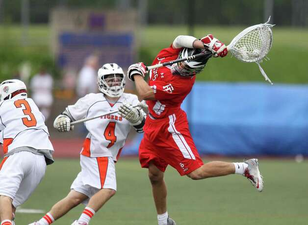 Fairfield Prep goalie Mike Seeley moves to get past Ridgefield lacrosse players Sean Riley and Sean Wilkenson at the CIAC Class L lacrosse final at Brien McMahon High School in Norwalk, Conn. on Saturday June 9, 2012. Fairfield Prep won 8-6. Photo: J. Gregory Raymond / Connecticut Post Freelance