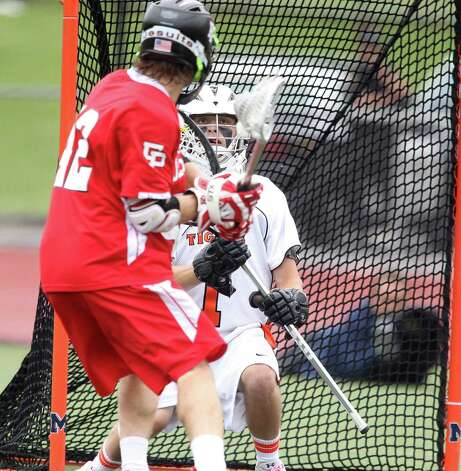 Ridgefield High School lacrosse goalie Adam Winne eyeballs Fairfield Prep's Matt Brophy during the Class L CIAC lacrosse final at Brien McMahon High School in Norwalk, Conn. on Saturday June 9, 2012. Prep won the game, 8-6. 6/9/12 Photo: J. Gregory Raymond / Connecticut Post Freelance