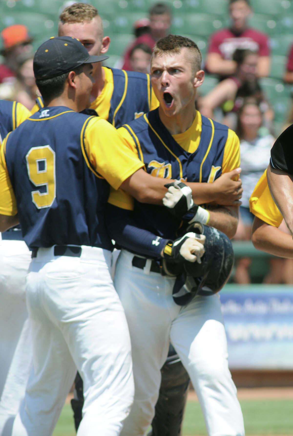 Cy-Ranch sophomore centerfielder Corbin Martin, right, is greeted by teammate Hernan Herrera (#9) after his homerun in the top of the second inning during the 2012 UIL Class 5A State Baseball Championship game versus A&M Consolidated at Dell Diamond in Round Rock on Saturday.