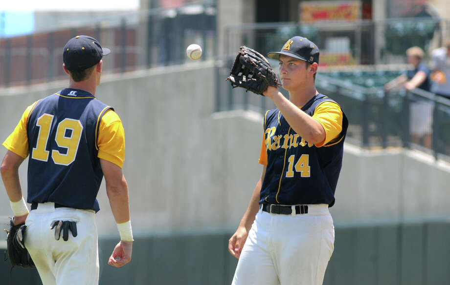 Cy-Ranch junior pitcher Zach Brosch takes the ball from senior 3rd baseman Justin Monsour for the start of the bottom of the 4th inning during the 2012 UIL Class 5A State Baseball Championship game versus A&M Consolidated at Dell Diamond in Round Rock on Saturday. Photo: Jerry Baker, For The Chronicle