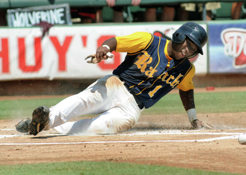 Cy-Ranch senior shortstop Leon Byrd scores the first run of the game for the Mustangs in the top of