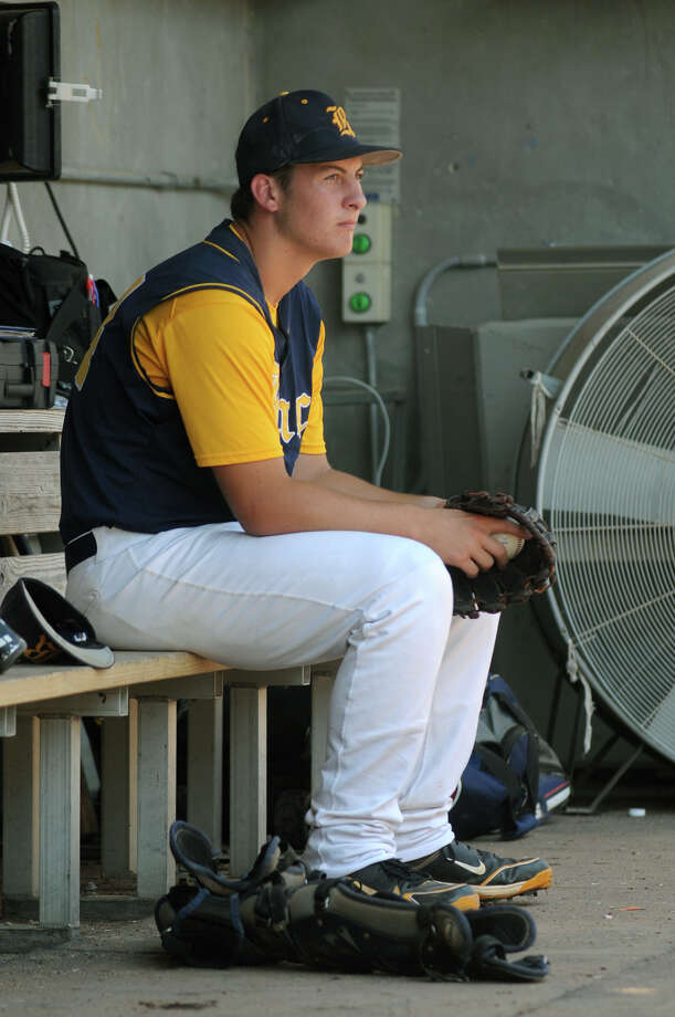 Cy-Ranch junior and starting pitcher Zach Brosch sits alone in the dugout during the top half of the 1st inning of the 2012 UIL Class 5A State Baseball Championship game versus A&M Consolidated at Dell Diamond in Round Rock on Saturday. Photo: Jerry Baker, For The Chronicle