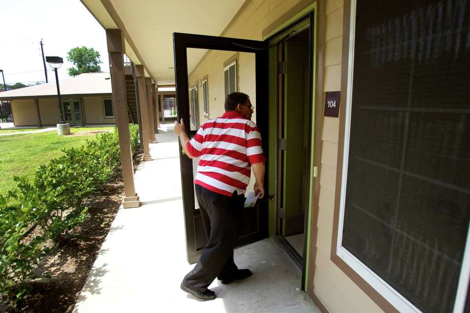 Charlie Tackett checks on his neighbor at the Acres Homes Garden Apartments. The complex provides subsidized housing for individuals with mental illness. Photo: Brett Coomer / © 2012 Houston Chronicle