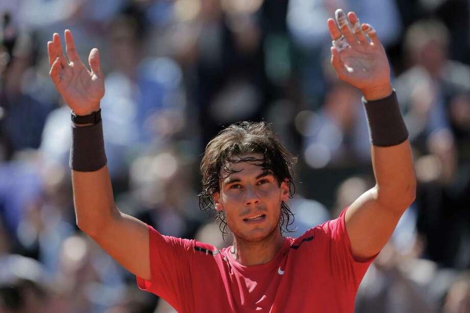 Rafael Nadal of Spain celebrates winning his semi final match against compatriot David Ferrer at the French Open tennis tournament in Roland Garros stadium in Paris, Friday June 8, 2012. Nadal won in three sets 6-2, 6-2, 6-1. (AP Photo/Bernat Armangue) Photo: Bernat Armangue / AP