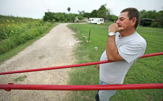 After many encounters with drug runners on his property, Eddy Cantu, of Pharr, TX, put up a locked gate across his driveway.  Cantu has lived on his Rio Grande River property all his life.  Thursday, May 3, 2012. Photo: Bob Owen, San Antonio Express-News / © 2012 San Antonio Express-News