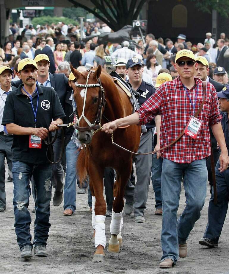 Kentucky Derby and Preakness winner I'll Have Another is walked to the track before a retirement ceremony before the start of the 144th Belmont Stakes at Belmont Park on June 9, 2012 in Elmont, New York. The triple crown hopeful is being retired due to an injury. Photo: Rob Carr, Getty Images / 2012 Getty Images