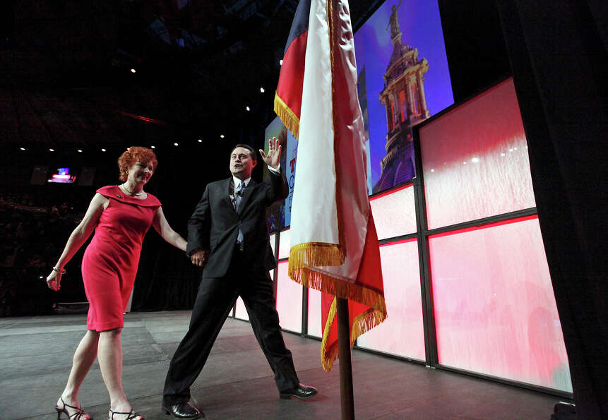 Janet Staples and her husband Texas Agricultural Commissioner Todd Staples leave the stage after his