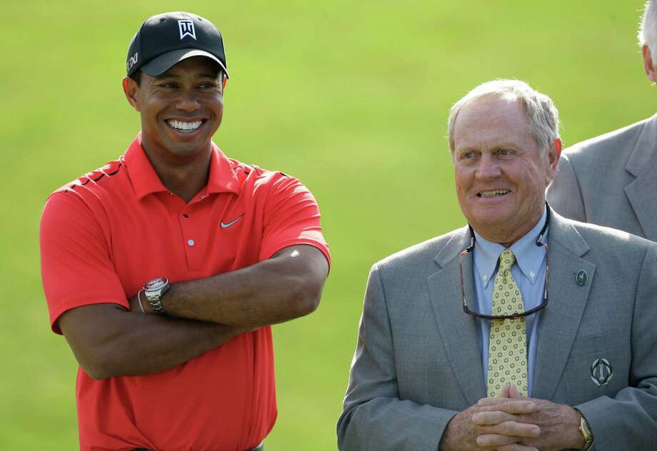 Jack Nicklaus, right, talks with Tiger Woods after Woods won the Memorial golf tournament at the Muirfield Village Golf Club in Dublin, Ohio, Sunday, June 3, 2012. (AP Photo/Tony Dejak) Photo: Tony Dejak / AP