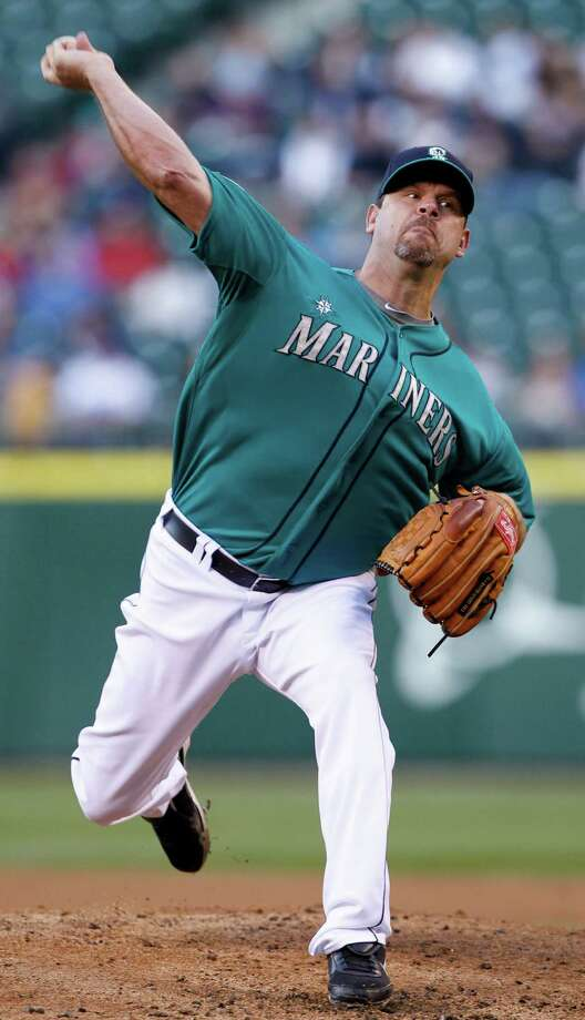 Seattle's Kevin Millwood (six innings) started, and Charlie Furbush (2⁄3 inning), Stephen Pryor (1⁄3), Lucas Luetge (1⁄3) and Brandon League (2⁄3) took their turns before Tom Wilhelmsen (1) put the finishing touches on a six-pitcher no-hitter and 1-0 victory over the Dodgers on Friday night, earning a hug from catcher Jesus Montero. Photo: Elaine Thompson / AP