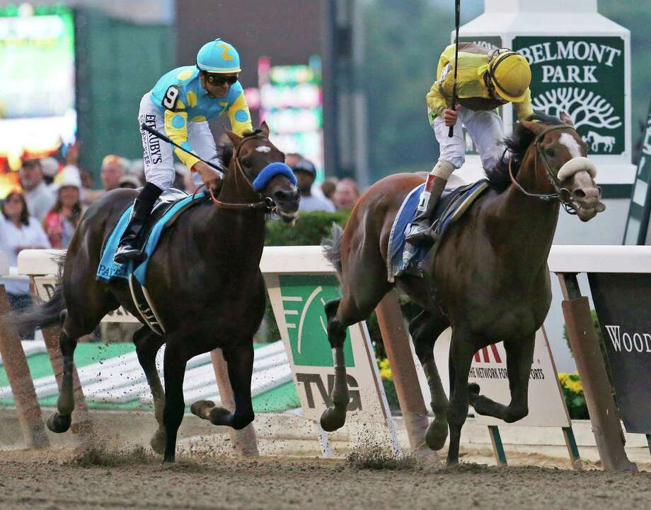 Union Rags, right, with jockey John Velazquez, holds off Paynter, with jockey Mike Smith, to win the Belmont Stakes horse race at Belmont Park in Elmont, N.Y., on Saturday, June 9, 2012. (AP Photo/Mark Lennihan) Photo: Mark Lennihan, Associated Press / AP