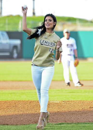 Former Miss Texas Ana Rodriguez throws the first pitch at the Laredo Lemurs baseball game, Saturday