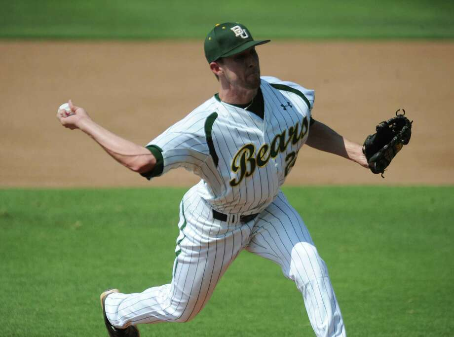 Baylor starting pitcher Trent Blank throws against Arkansas in the first inning of an NCAA college baseball tournament super regional game, Saturday, June 9, 2012, in Waco, Texas. (AP Photo/Waco Tribune Herald, Rod Aydelotte) Photo: Rod Aydelotte, Associated Press / Waco Tribune Herald