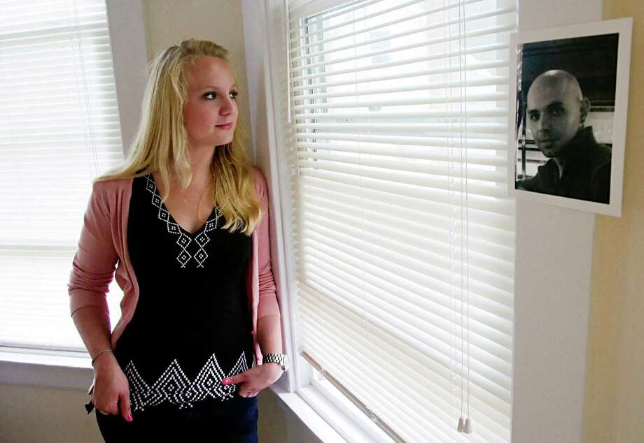 Wanda Szarek with a photograph of her cousin in her Stamford, Conn., home, June 6, 2012. Szarek had suicide touch her life three times in the space of five months, losing a high school friend, a college classmate and the cousin pictured here. Photo: Keelin Daly / Stamford Advocate