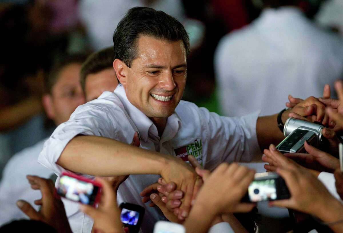 Mexican presidential candidate Enrique Peña Nieto, of the Revolutionary Institutional Party, the party that ruled for decades, greets supporters. With three weeks to go before elections, he holds a commanding lead.
