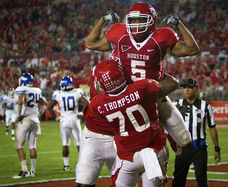 Charles Sims (5) and the Coogs could be celebrating a conference title in their final season in C-USA. Photo: Smiley N. Pool / © 2011  Houston Chronicle