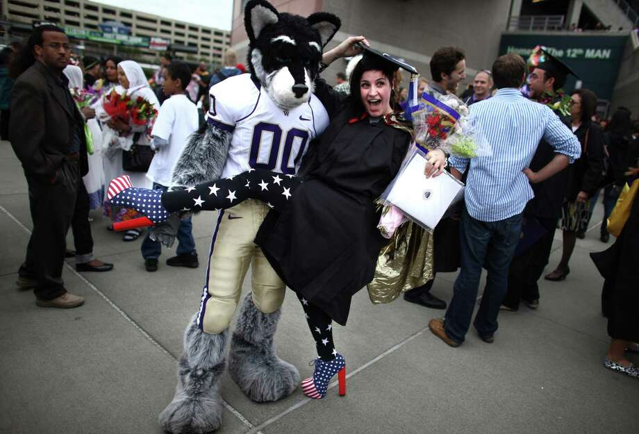 Mimi Ator has some fun with Harry the Husky. Photo: JOSHUA TRUJILLO / SEATTLEPI.COM