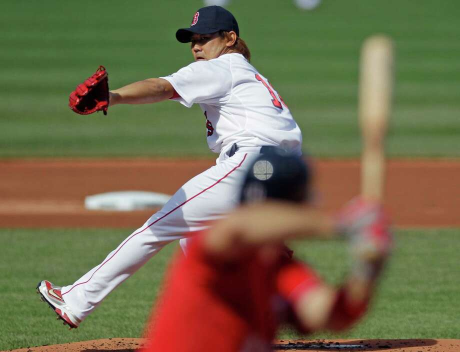 Boston's Daisuke Matsuzaka makes his return to the mound a year after Tommy John surgery in a 4-2 loss to the visiting Nationals. Photo: Charles Krupa / AP
