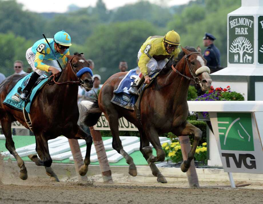 Union Rags comes up the rail, right with jockey John Velazquez to beat Paynter with Mike Smith to win the 144th running of The Belmont Stakes at Belmont Park in Elmont, N.Y. June 9, 2012.  (Skip Dickstein / Times Union) Photo: SKIP DICKSTEIN
