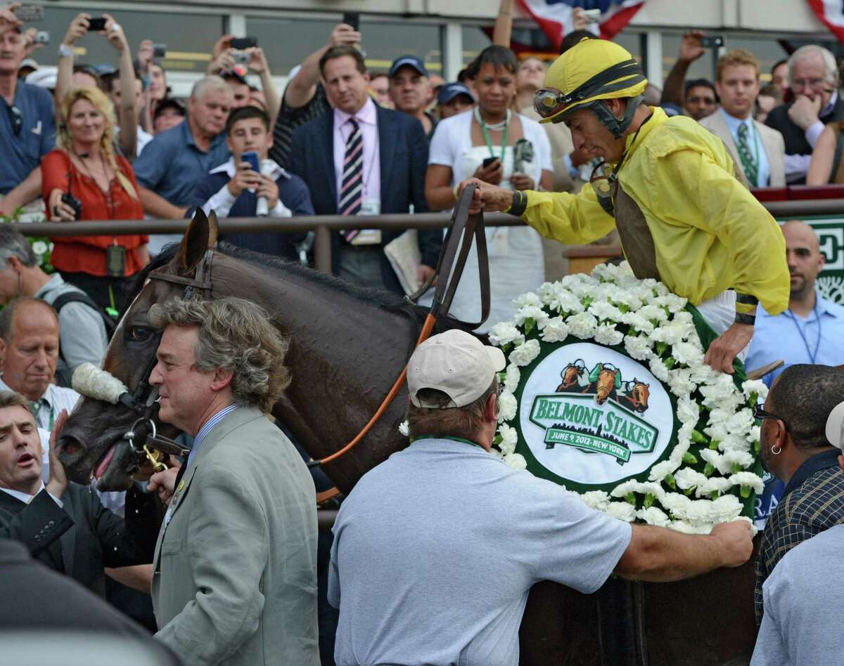 Union Rags with jockey John Velazquez enters the winner's circle and gets the ceremonial blanket of carnations after beating Paynter with Mike Smith to win the 144th running of The Belmont Stakes at Belmont Park in Elmont, N.Y. June 9, 2012. (Skip Dickstein / Times Union)