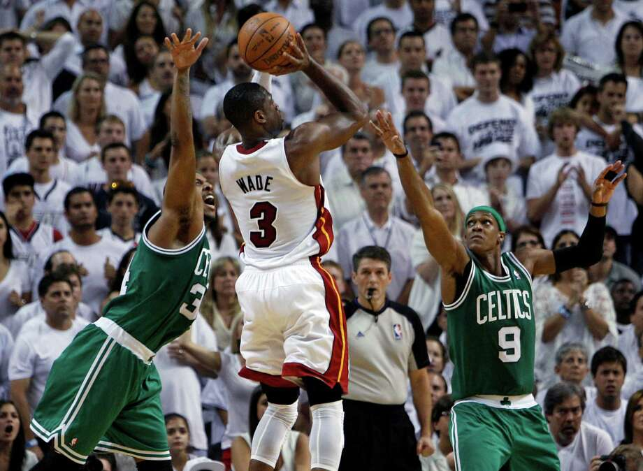 Miami Heat's Dwyane Wade (3) drives to the basket as Boston Celtics' Rajon Rondo (9) and Paul Pierce (34) defend during the second half of Game 7 of the NBA basketball playoffs Eastern Conference finals, Saturday, June 9, 2012, in Miami. The Heat defeated the Celtics 101-88. (AP Photo/Lynne Sladky) Photo: Lynne Sladky, Associated Press / AP