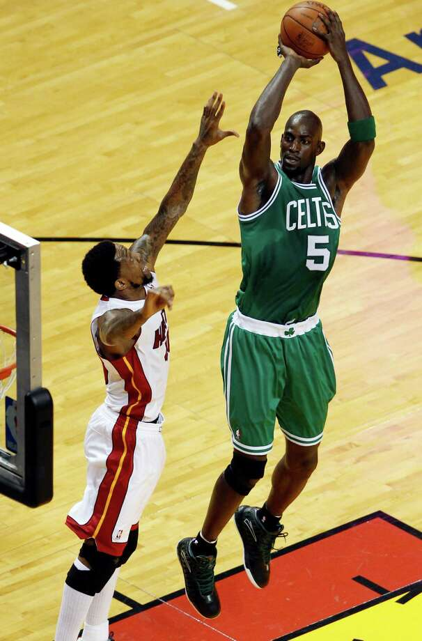 Boston Celtics' Kevin Garnett (5) shoots over Miami Heat's Udonis Haslem during the first half of Game 7 of the NBA basketball playoffs Eastern Conference finals, Saturday, June 9, 2012, in Miami. (AP Photo/Wilfredo Lee) Photo: Wilfredo Lee, Associated Press / AP