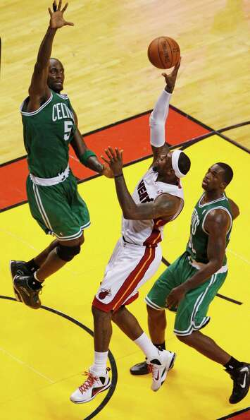 Miami Heat's LeBron James (6) drives to the basket as Boston Celtics' Kevin Garnett (5) defends duri