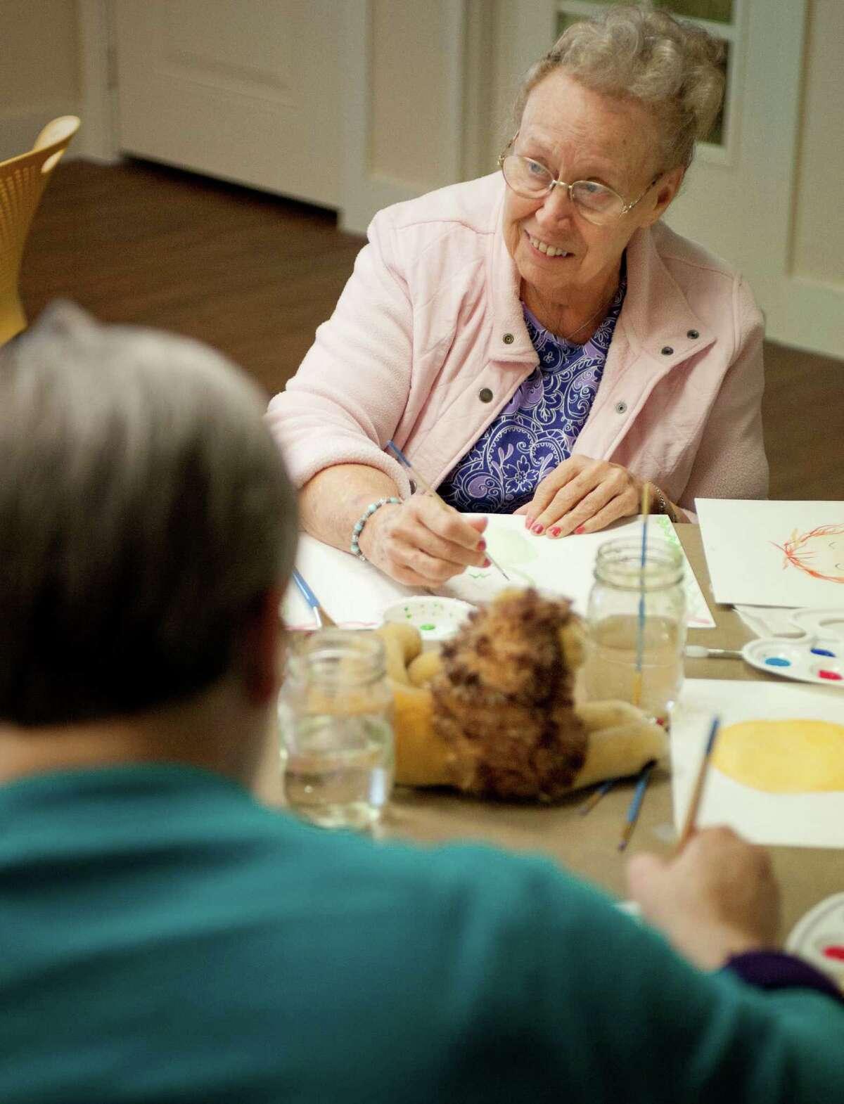 Doris Maynard, right, paints during a memory art class, Monday, June 4, 2012, at Franklin Park in San Antonio. (Darren Abate/Express-News)