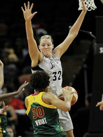 San Antonio Silver Stars' Jayne Appel (32) blocks Seattle Storm's Tanisha Wright during the first half of a WNBA basketball game, Saturday, June 9, 2012, in San Antonio. San Antonio won 80-67. Photo: Darren Abate, Express-News
