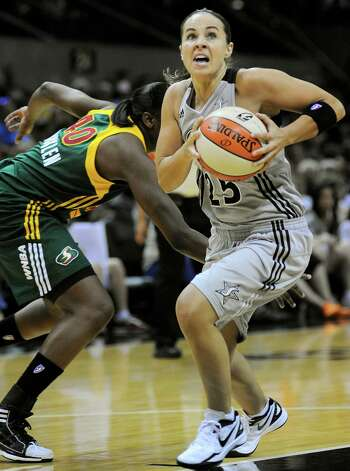 San Antonio Silver Stars' Becky Hammon (25) evades Seattle Storm's Shekinna Stricklen during the first half of a WNBA basketball game, Saturday, June 9, 2012, in San Antonio. San Antonio won 80-67. Photo: Darren Abate, Express-News