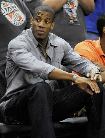 Former San Antonio Spurs player Antonio Daniels watches a WNBA basketball game between the San Antonio Silver Stars and the Seattle Storm, Saturday, June 9, 2012, in San Antonio. San Antonio won 80-67. Photo: Darren Abate, Express-News