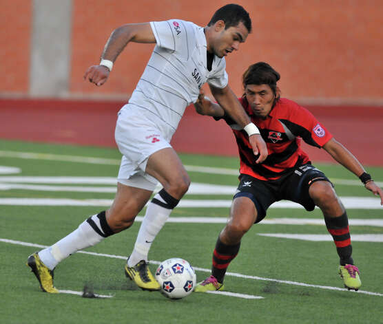Pablo Campos of the San Antonio Scorpions drives on Atlanta Silverbacks Kohei Matsushita during first half action Saturday at Heroes stadium. Photo: Robin Jerstad, Express-News / Jerstad Photographics LLC