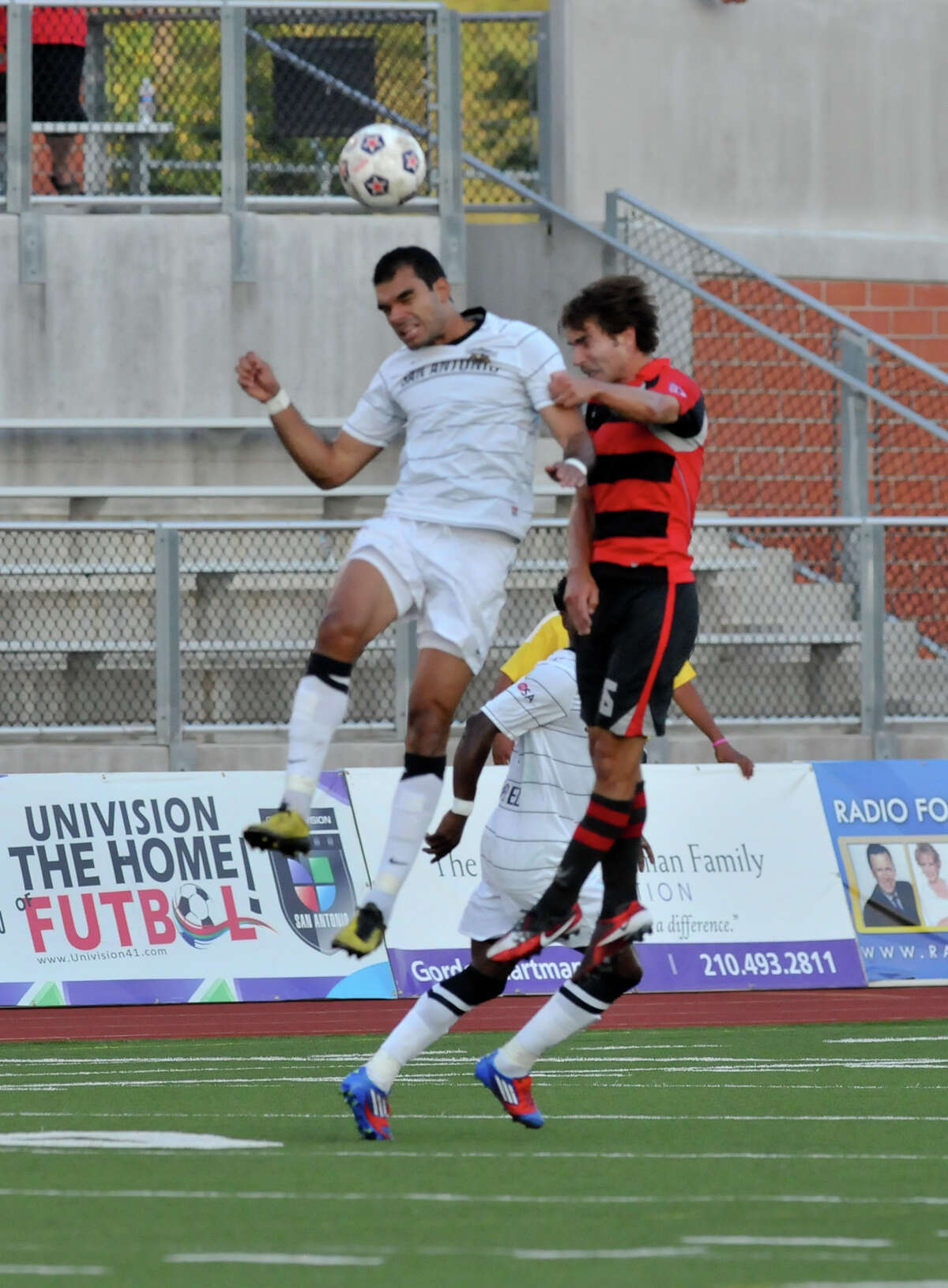 Scorpions Pablo Campos heads the ball in front of Atlanta Silverbacks Jordan Davis during first half action Saturday evening at Heroes Stadium.