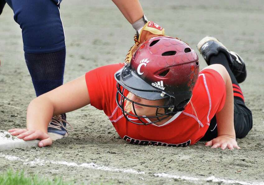 Chatham's #2 Courtney Mesick beats the pick off throw during their state championship softball game