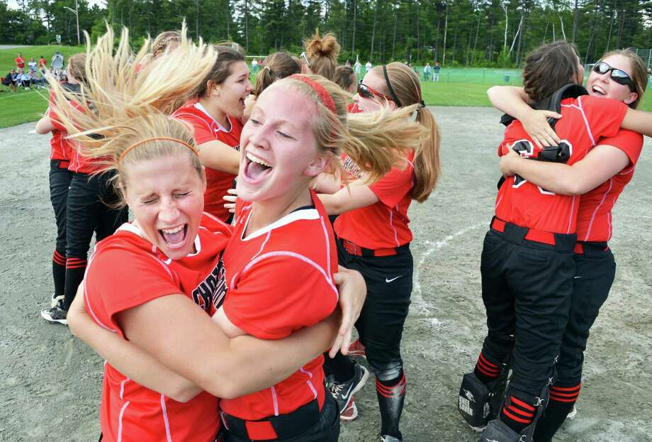 Sisters Courtney, left, and Allison Mesick hug as they and Chatham'team mates celebrate their win over Mynderse Academy in the state championship softball game in Queensbury Saturday June 9, 2012.   (John Carl D'Annibale / Times Union) Photo: John Carl D'Annibale / 00018031A