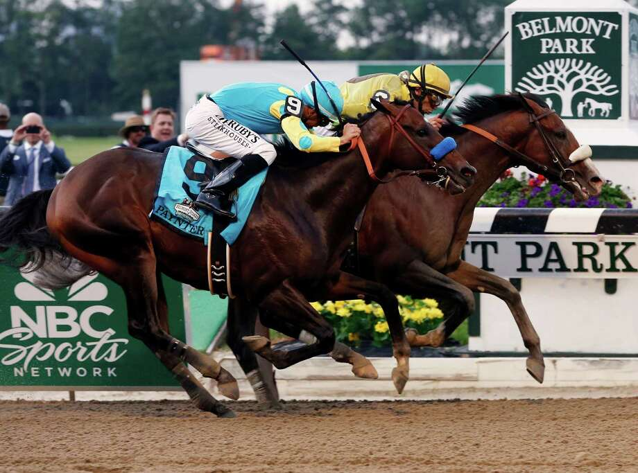 Union Rags with jockey John Velazquez in the irons, right, pulls the rug out from under Paynter and jockey Mike Smith by riding along the rail to take inside position and the win Saturday at Belmont Park. Photo: Mike Groll / AP