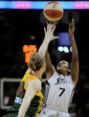 San Antonio Silver Stars' Jia Perkins (7) shoots over Seattle Storm's Katie Smith during the first half of a WNBA basketball game, Saturday, June 9, 2012, in San Antonio. San Antonio won 80-67. Photo: Darren Abate, Express-News