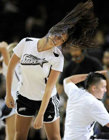 Members of the San Antonio Silver Stars Star Squad dance team perform during the first half of a WNBA basketball game against the Seattle Storm, Saturday, June 9, 2012, in San Antonio. San Antonio won 80-67. Photo: Darren Abate, Express-News