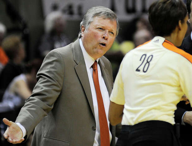 San Antonio Silver Stars head coach Dan Hughes disagrees with a call during the second half of a WNBA basketball game against the Seattle Storm, Saturday, June 9, 2012, in San Antonio. San Antonio won 80-67. Photo: Darren Abate, Express-News