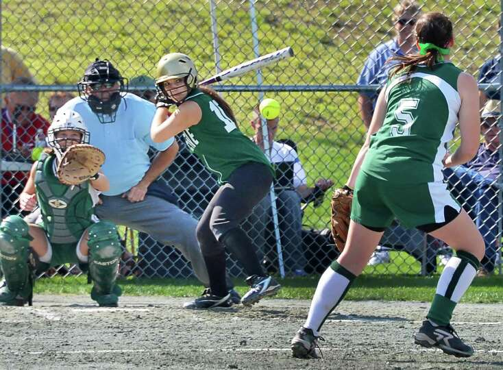 Greenwich pitcher Rachel Albrecht, at right, strikes out Greene Central School's Morgan Ellis in the
