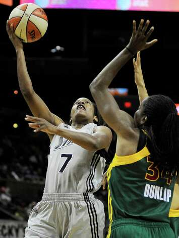 San Antonio Silver Stars' Jia Perkins (7) shoots over Seattle Storm's Victoria Dunlap during the second half of a WNBA basketball game, Saturday, June 9, 2012, in San Antonio. San Antonio won 80-67. Photo: Darren Abate, Express-News