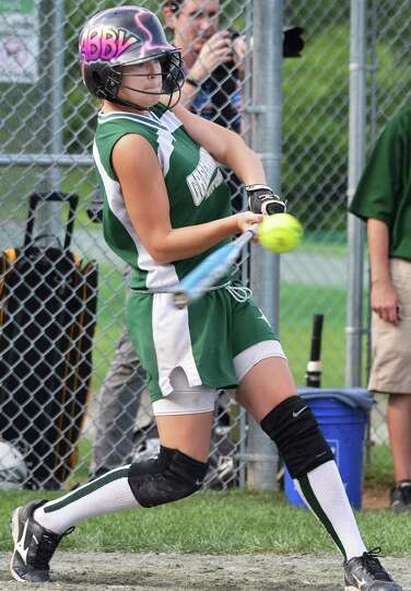 Greenwich's #7 Abigail Dusha gets a hit against Greene Central School in the state class C champions