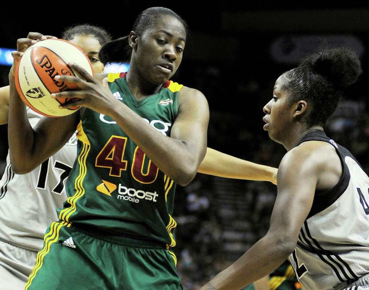 Seattle Storm's Shekinna Stricklen (40) is defended by San Antonio Silver Stars' Shenise Johnson, right, and Ziomara Morrison, of Chile, during the second half of a WNBA basketball game, Saturday, June 9, 2012, in San Antonio. San Antonio won 80-67.