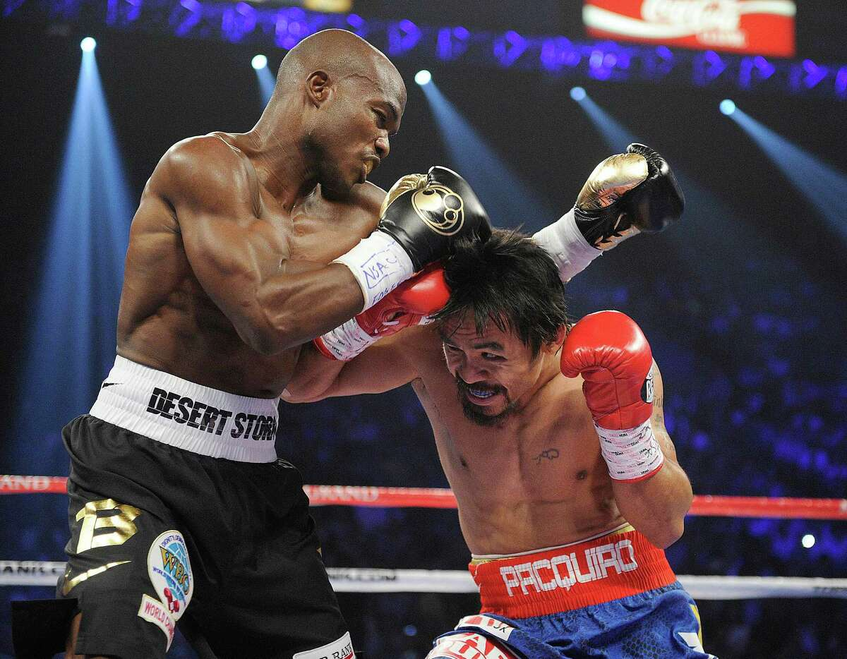 Manny Pacquiao (right) appeared to have things in hand against Timothy Bradley - until the decision was announced.