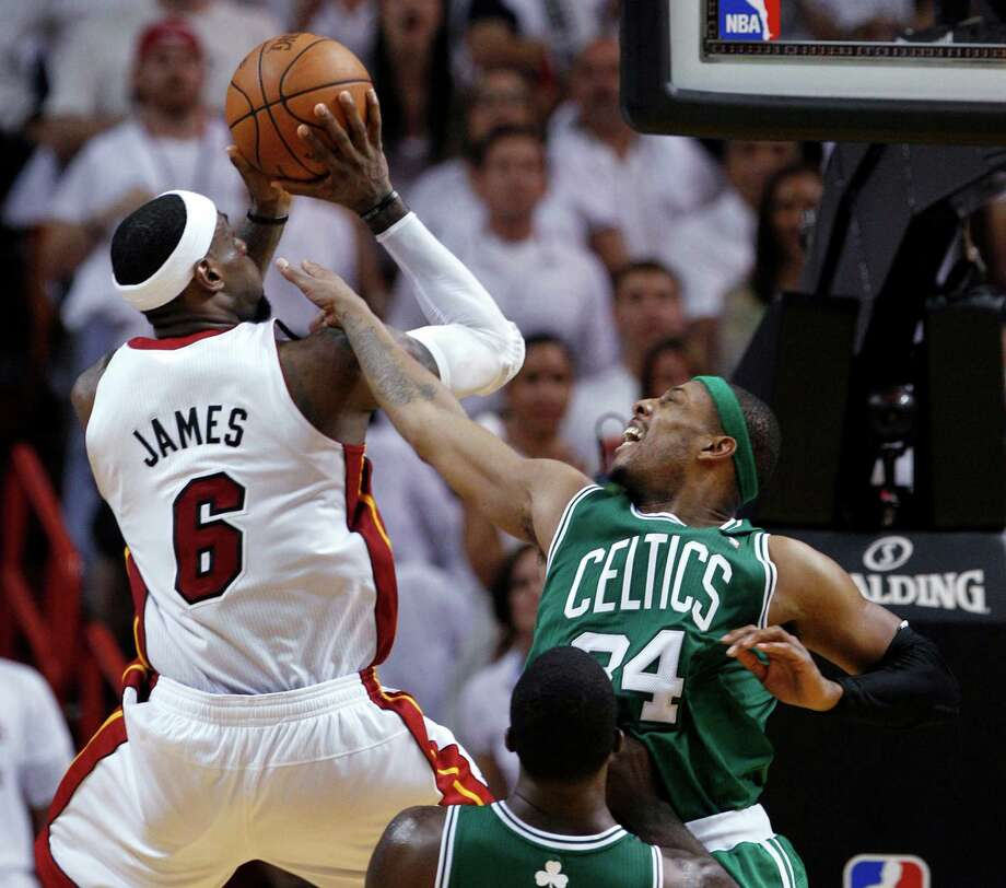 There was no stopping LeBron James in Game 7 as Paul Pierce, right, and the Celtics found out Saturday night. James had a game-high 31 points. Photo: Lynne Sladky / AP