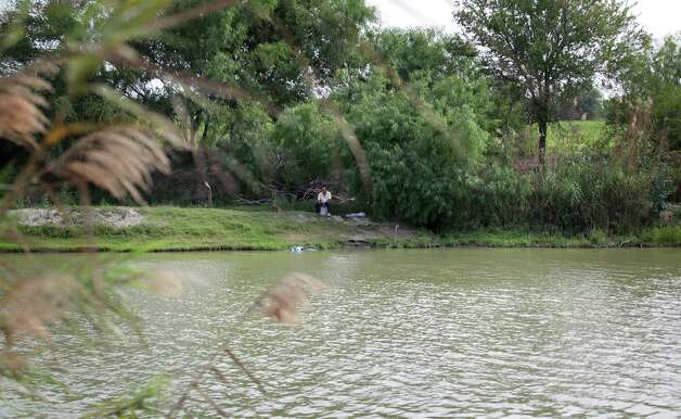 A man fishes on the Mexico side of the Rio Grande River.  Drug traffickers hire spotters to watch activity along the river.  Thursday, May 3, 2012.  Photo/Bob Owen Photo: Bob Owen, San Antonio Express-News / © 2012 San Antonio Express-News