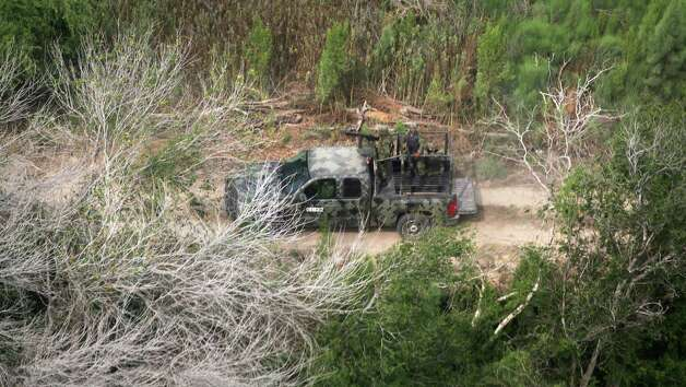 Mexican troops patrol the farm roads along the Rio Grande River in Mexico.  Thursday, May 3, 2012. Photo: Bob Owen, San Antonio Express-News / © 2012 San Antonio Express-News